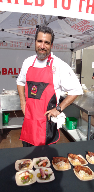 Executive Chef Colin MacLaggan mans the grilling station at the Ballast Point Smoke Beer Dinner on August 24, 2014.